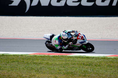 adriatico: Misano Adriatico, Italy - June 21, 2015: Kawasaki ZX-10R of Team OGP, driven by PAGAUD Randy  in action during the Superstock 1000 Race during the FIM Superstock 1000 - race at Misano World Circuit on June 21, 2015 in Misano Adriatico, Italy.