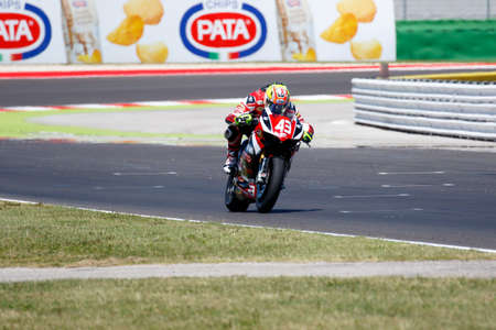 adriatico: Misano Adriatico, Italy - June 21, 2015: Ducati 1199 Panigale R of EAB Racing Team, driven by MASSEI Fabio  in action during the Superstock 1000 Race during the FIM Superstock 1000 - race at Misano World Circuit on June 21, 2015 in Misano Adriatico, Italy Editorial