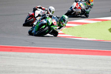 adriatico: Misano Adriatico, Italy - June 21, 2015: Kawasaki ZX-10R of Pedercini Team, driven by CECCHINI Riccardo in action during the Superstock 1000 Race during the FIM Superstock 1000 - race at Misano World Circuit on June 21, 2015 in Misano Adriatico, Italy.