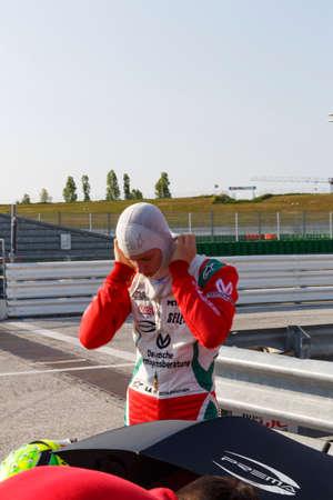 adriatico: Misano Adriatico, Italy - April 10, 2016: A Tatuus F4 T014 Abarth of Prema Power Team team, driven by Schumacher Mick,  the Italian F4 Championship Powered by Abarth in Misano World Circuit, in Misano Adriatico, Italy.