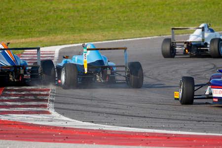 adriatico: Misano Adriatico, Italy - April 10, 2016: A Tatuus F4 T014 Abarth of Jenzer Motorsport Team, driven by Meikup Jan-Erik,  the Italian F4 Championship Powered by Abarth in Misano World Circuit, in Misano Adriatico, Italy.