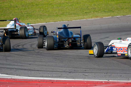 cram: Misano Adriatico, Italy - April 10, 2016: A Tatuus F4 T014 Abarth of Cram Motorsport Team, driven by Vartanyan Alexander,  the Italian F4 Championship Powered by Abarth in Misano World Circuit, in Misano Adriatico, Italy.
