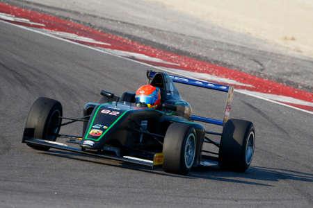 cram: Misano Adriatico, Italy - April 10, 2016: A Tatuus F4 T014 Abarth of Cram Motorsport Team, driven by Hoogenboom Leonard,  the Italian F4 Championship Powered by Abarth in Misano World Circuit, in Misano Adriatico, Italy. Editorial