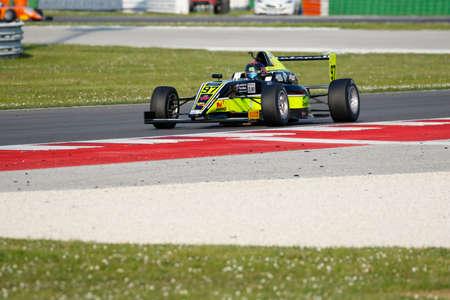 adriatico: Misano Adriatico, Italy - April 10, 2016: A Tatuus F4 T014 Abarth of Antonelli Motorsport Team, driven by Vieira Queiroz Joao Ricardo,  the Italian F4 Championship Powered by Abarth in Misano World Circuit, in Misano Adriatico, Italy.