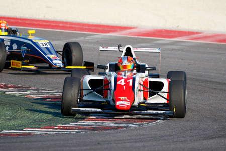 adriatico: Misano Adriatico, Italy - April 10, 2016: A Tatuus F4 T014 Abarth of DR Formula Team, driven by Guzman Marchina Raul,  the Italian F4 Championship Powered by Abarth in Misano World Circuit, in Misano Adriatico, Italy.