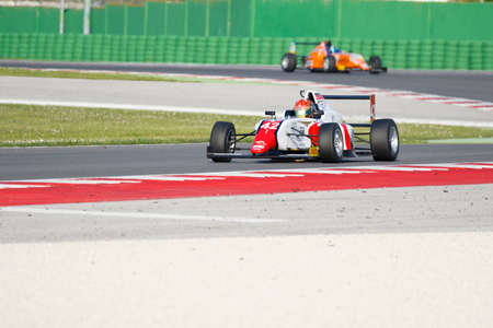 dr: Misano Adriatico, Italy - April 10, 2016: A Tatuus F4 T014 Abarth of DR Formula Team, driven by Artem Petrov,  the Italian F4 Championship Powered by Abarth in Misano World Circuit, in Misano Adriatico, Italy.