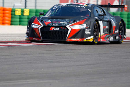 frederic: Misano Adriatico, Italy - April 10, 2016: Audi R8 LMS of Belgian Audi Club Team WRT, driven by Frederic Vervisch and Laurens Vanthoor,  the Blancpain GT Series Sprint Cup in Misano World Circuit. Editorial
