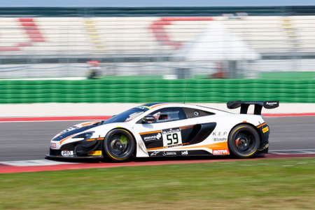gt3: Misano Adriatico, Italy - April 10, 2016: McLaren 650 S GT3 of Garage 59 Team, driven by Martin Plowman and Craig Dolby,  the Blancpain GT Series Sprint Cup in Misano World Circuit. Editorial