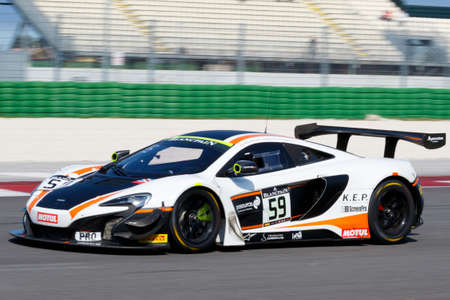 adriatico: Misano Adriatico, Italy - April 10, 2016: McLaren 650 S GT3 of Garage 59 Team, driven by Martin Plowman and Craig Dolby,  the Blancpain GT Series Sprint Cup in Misano World Circuit. Editorial