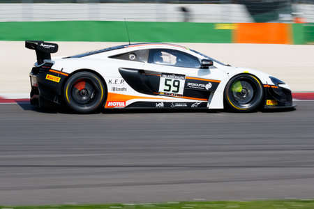 gt: Misano Adriatico, Italy - April 10, 2016: McLaren 650 S GT3 of Garage 59 Team, driven by Martin Plowman and Craig Dolby,  the Blancpain GT Series Sprint Cup in Misano World Circuit. Editorial