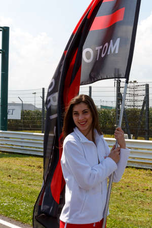 adriatico: Misano Adriatico, Italy - April 10, 2016: A grid girl poses during the Blancpain GT Series Sprint Cup in Misano World Circuit, in Misano Adriatico, Italy.