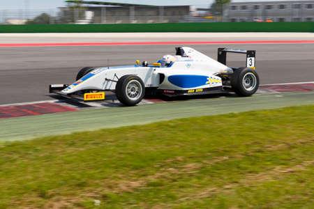 simone: Misano Adriatico, Italy - April 10, 2016: A Tatuus F4 T014 Abarth of Vincenzo Sospiri Racing  team, driven by Cunati Simone,  the Italian F4 Championship Powered by Abarth in Misano World Circuit
