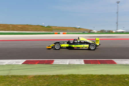 powered: Misano Adriatico, Italy - April 10, 2016: A Tatuus F4 T014 Abarth of Antonelli Motorsport Team, driven by Vieira Queiroz Joao Ricardo,  the Italian F4 Championship Powered by Abarth in Misano World Circuit Editorial
