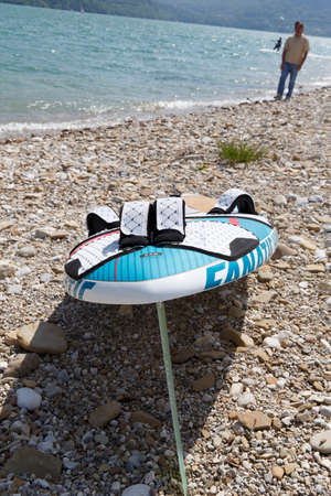 kitesurf: Lake Of Santa Croce, Italy – May 21, 2016: Kitesurfing action at the lake. Preparation, starting from the beach, sailing in the lake