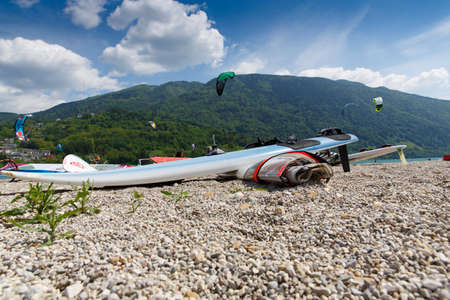 windsurf: Lake Of Santa Croce, Italy – May 21, 2016: windsurfing sport equipment on Lake of Santa Croce Beach, Alpago, Belluno, Veneto, Italy Editorial