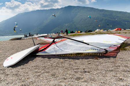 kitesurf: Lake Of Santa Croce, Italy – May 21, 2016: windsurfing sport equipment on Lake of Santa Croce Beach, Alpago, Belluno, Veneto, Italy Editorial