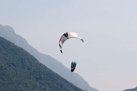 kitesurf: Lake Of Santa Croce, Italy – May 21, 2016: A surging kite lying on a beach in the lake of Santa Croce