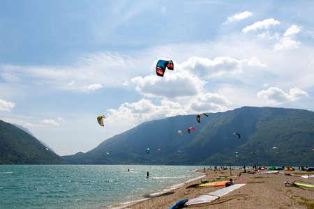 kitesurf: Lake Of Santa Croce, Italy – May 21, 2016:Kitesurfer launches his kite in the lake of Santa Croce