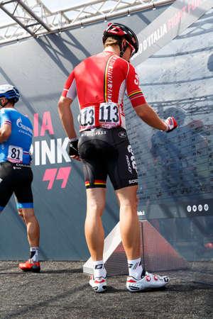 sean: Farra dAlpago lake Santa Croce, Italy - May21, 2016: DE BIE Sean signs the board before the start of the 14th stage of the 99th Giro dItalia