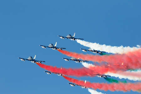 tricolour: Alta Badia, Italy 20 December 2015: Italian special unit airforce Frecce Tricolori (Tri-colour Arrows) spread smoke with the colours of the Italian flag during the Audi Fis Alpine Skiing World Cup Men's Giant Slalom Race.