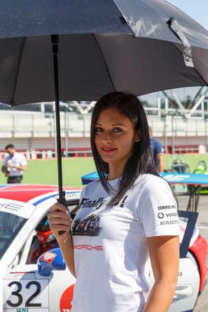Imola, Italy - September 25, 2016: A grid girl poses during the Porsche Carrera Cup Italia - Race in Imola at Enzo & Dino Ferrari Circuit on September 25, 2016 in Imola, Italy.
