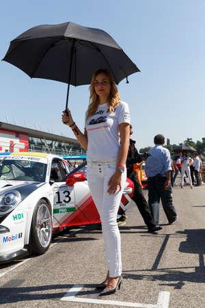 carrera: Imola, Italy - September 25, 2016: A grid girl poses during the Porsche Carrera Cup Italia - Race in Imola at Enzo & Dino Ferrari Circuit on September 25, 2016 in Imola, Italy.