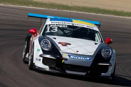 Imola, Italy - September 25, 2016: A Porsche 911 Gt3 Cup of Tsunami Rt team, driven By Gaidai Oleksandr and LEDOGAR Come,  the Porsche Carrera Cup Italia car racing on September 25, 2016 in Imola, Italy. Editöryel
