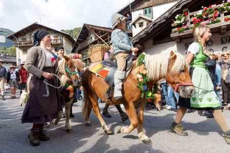 returning: Falcade, Belluno, Italy - September 24, 2016: Se Desmonteghea a great party in Falcade for the livestock returning from the highland pastures