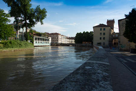 Bacchiglione river in flood, and the city at risk of flooding. Homes evacuated and the danger of flooding. Redakční