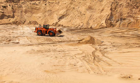 sand pit: The excavator works in the sandy quarry sand mining sand pit