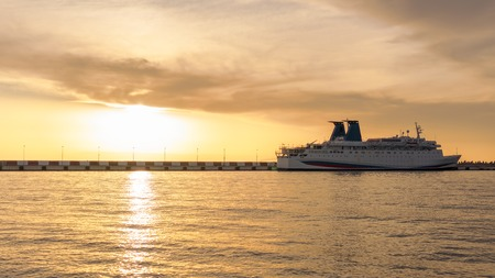 Sea cruise liner moored in the harbor at sunset. Background copy space Standard-Bild - 117355765