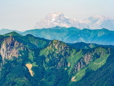 Top view of the mountain range and peaks covered with snow. Mountain peak in the summer.