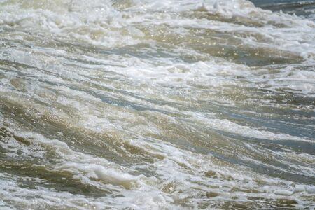 Sea wave during storm at Black sea in Sochi, Russia. Muddy sea waves with foam. Stock Photo