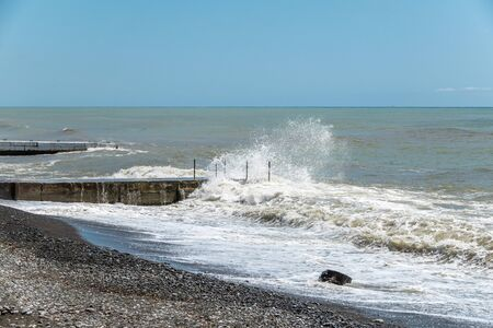 Sea wave with spray during storm at Black sea in Sochi, Russia. Muddy sea waves with foam and spray. 版權商用圖片