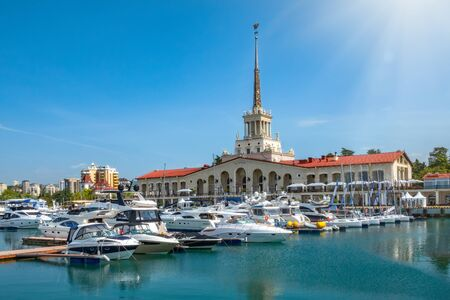 Sochi Marine Station and the yacht pier next to it on a clear summer day. Translation of the inscription above the central entrance to the building means Sochi .