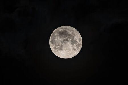 Detailed image of the full moon. Full moon against the black night sky. Stock fotó