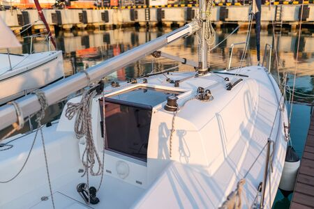 White deck of a sailing yacht. The yacht stands on the pier Stok Fotoğraf