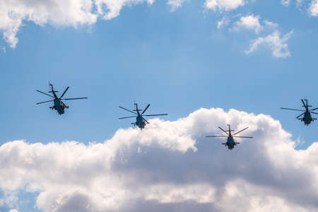 Moscow, Russia - May, 05, 2021: MI-8 multipurpose helicopters fly over Red Square during the General rehearsal of the parade celebrating Victory Day in Moscow