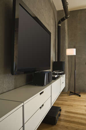 Large flat panel television and entertainment center in a modern loft. Vertical shot. photo