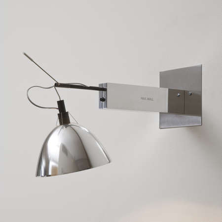 light fixture: Modern light fixture with exposed wires coming out of the wall. Square shot.