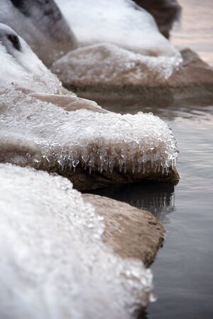 ice covered rocks along icy cold Lake Michigan in winter Banco de Imagens