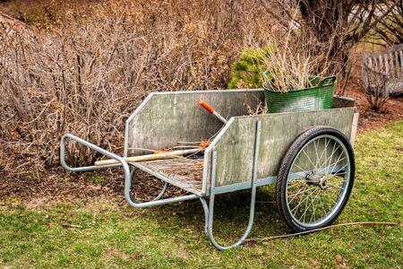 garden cart outside during spring cleanup Reklamní fotografie