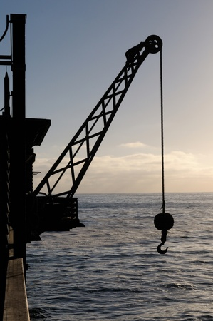 swakopmund: Hoisting crane silhouette at the jetty in Swakopmund Namibia
