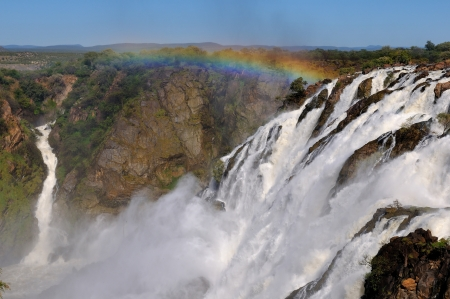 Rainbow over the Ruacana waterfalls on the boder between Angola and Namibia  Stock Photo