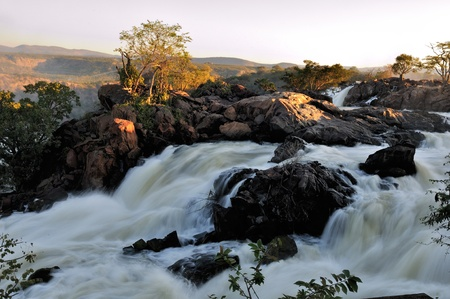 Top of of the Ruacana waterfalls, Namibia at sunset photo