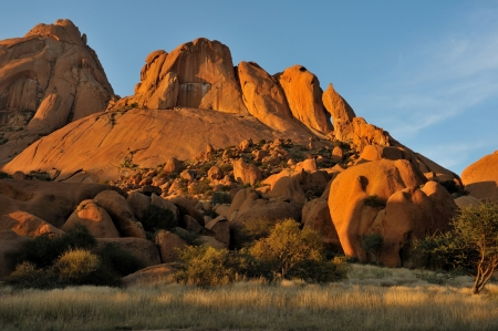Spitzkoppe in Namibia at sunset. The sandstone becomes a deep orange during sunset