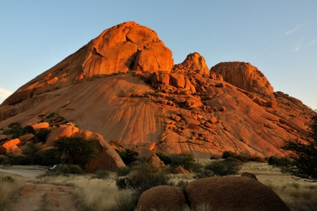 deep orange: Spitzkoppe in Namibia at sunset. The sandstone becomes a deep orange during sunset