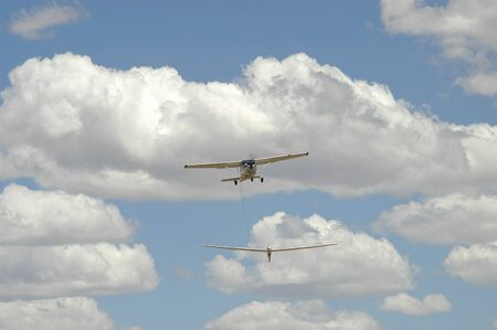 Aeroplane towing glider into the air at Tempe Airport near Bloemfontein, South Africa Stock Photo