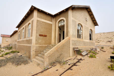 kolmanskop: Ruin of the hospital at Kolmanskop near Luderitz in Namibia Stock Photo