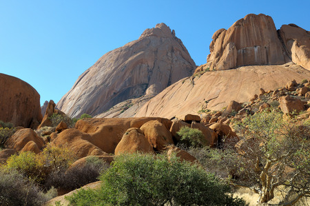 spitzkoppe: Spitzkoppe with sandstone boulders in the foreground, Namibia